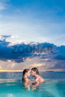 Young couple enjoying a romantic swim