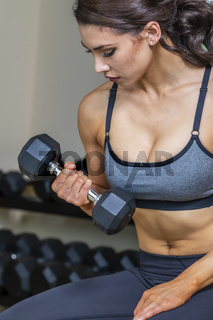 Gorgeous Brunette Fitness Model Working Out In A Studio Environment