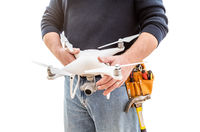 Construction Worker and Drone Pilot With Toolbelt Holding Drone Isolated on White Backround