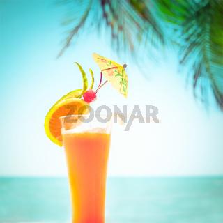 Tequila sunrise cocktail at tropical ocean beach