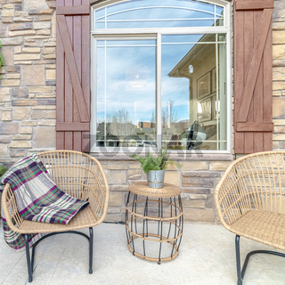 Square frame Comfortable wicker chairs on a veranda day light