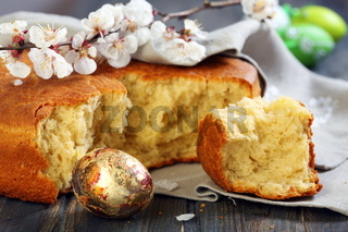 Flowering branch of apricot and Italian Easter bread.