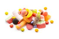 Assortment of candies and sweets isolated on white background