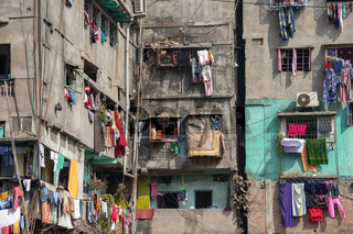 Old town of Calcutta.Laundries are hanged on the wall of the old and dilapidated buildings.Some of the old buildings used for billboards also.