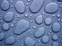 Raindrops on a blue tablecloth