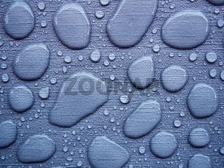 Raindrops on a blue tablecloth