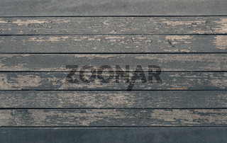 Old wood planks with peeling paint, rustic background with space for text