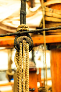 Detail of a sailing boat, block with rope.
