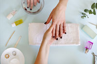 Woman getting manicure procedure in salon