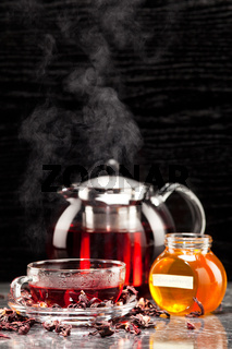 Mallow tea in glass cup with honey