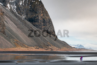 People enjoying the scenery of the Vestrahorn mountain near Hofn village in Iceland Europe