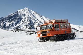 Snowcat transportation sportsman on snowy slopes of volcano Kamchatka Peninsula