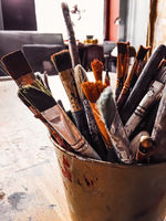 Art tools in artist studio, paint brushes and oil palette, creative hobby and artistic workspace
