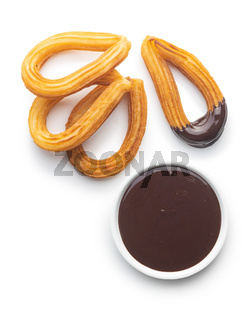 Tasty fried churros with chocolate dip
