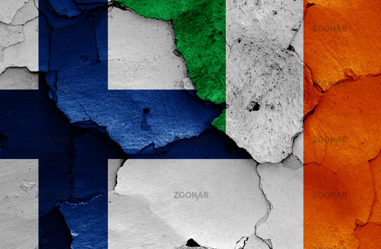 flags of Finland and Ireland painted on cracked wall