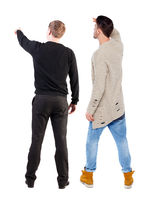 Back view of two man in sweater pointing.