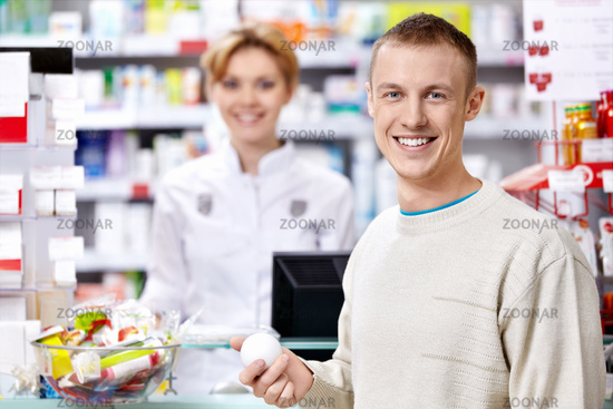 The pharmacist and the customer at the counter