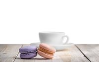 Two macaroons with a cup coffee