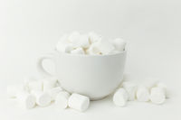 Marshmallow in the cup on the white background