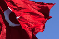 Turkish flag waving in wind at blue sky