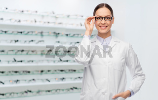 smiling female doctor in glasses at optical store