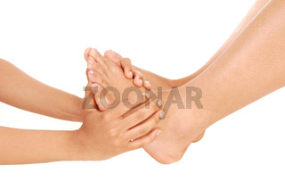 Hands holding the feet of a young woman
