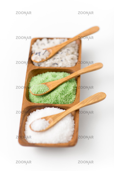 sea salt and spoons on wooden tray