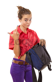 angry teenage girl holding a bag and  giving middle finger, isolated on white