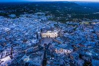 aerial view at dusk, Mountain village, Ostuni, Apulia, Southern Italy