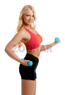 Sexy girl doing fitness exercise with dumbbells