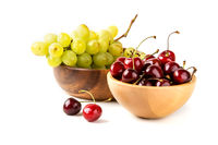 Grapes and cherry in the bowls