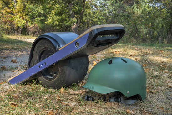 one-wheeled electric skateboard on a forest trail