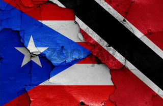 flags of Puerto Rico and Trinidad and Tobago painted on cracked wall