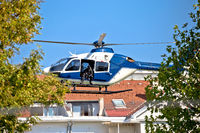 Police sniper in helicopter urban area low flight view