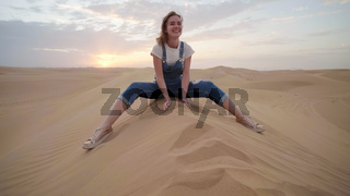 Happy girl in the desert of the arab emirates.