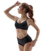 Cute fitness girl posing standing on tiptoe
