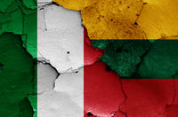 flags of Italy and Lithuania painted on cracked wall