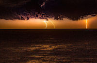 Storm over the ocean with lightning
