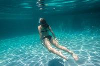 Girl Underwater Surfacing