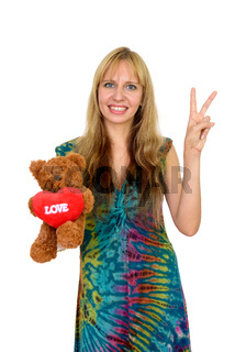 Portrait of happy beautiful blonde woman with teddy bear ready for Valentine's day