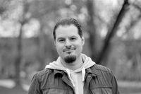 Man walking in the park. Analog film portrait shot on 35mm film.