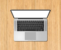 Open laptop top view with blank screen on wooden desk. 3D render