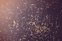 Colorful confetti on dark table