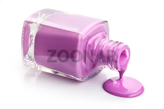 flowing pink nail polish isolated on white