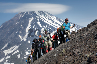 Group of hikers go hiking and climbing to the top of volcano
