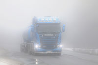 Blue Scania Trucking Through Fog