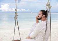 Businessman freelance on beach dreaming. Sand beach