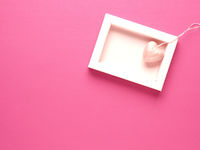 Heart shape in a box on a pink background
