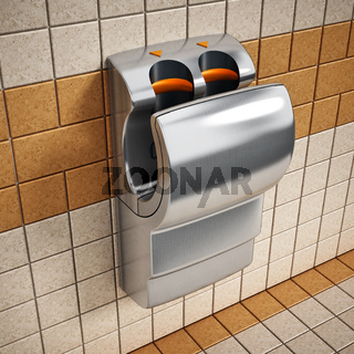 Hand dryer hanging on the wall
