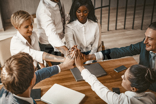 High Five Of Business Group During Meeting in Office